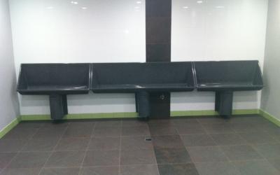 Uridan trough urinals in commercial amenities
